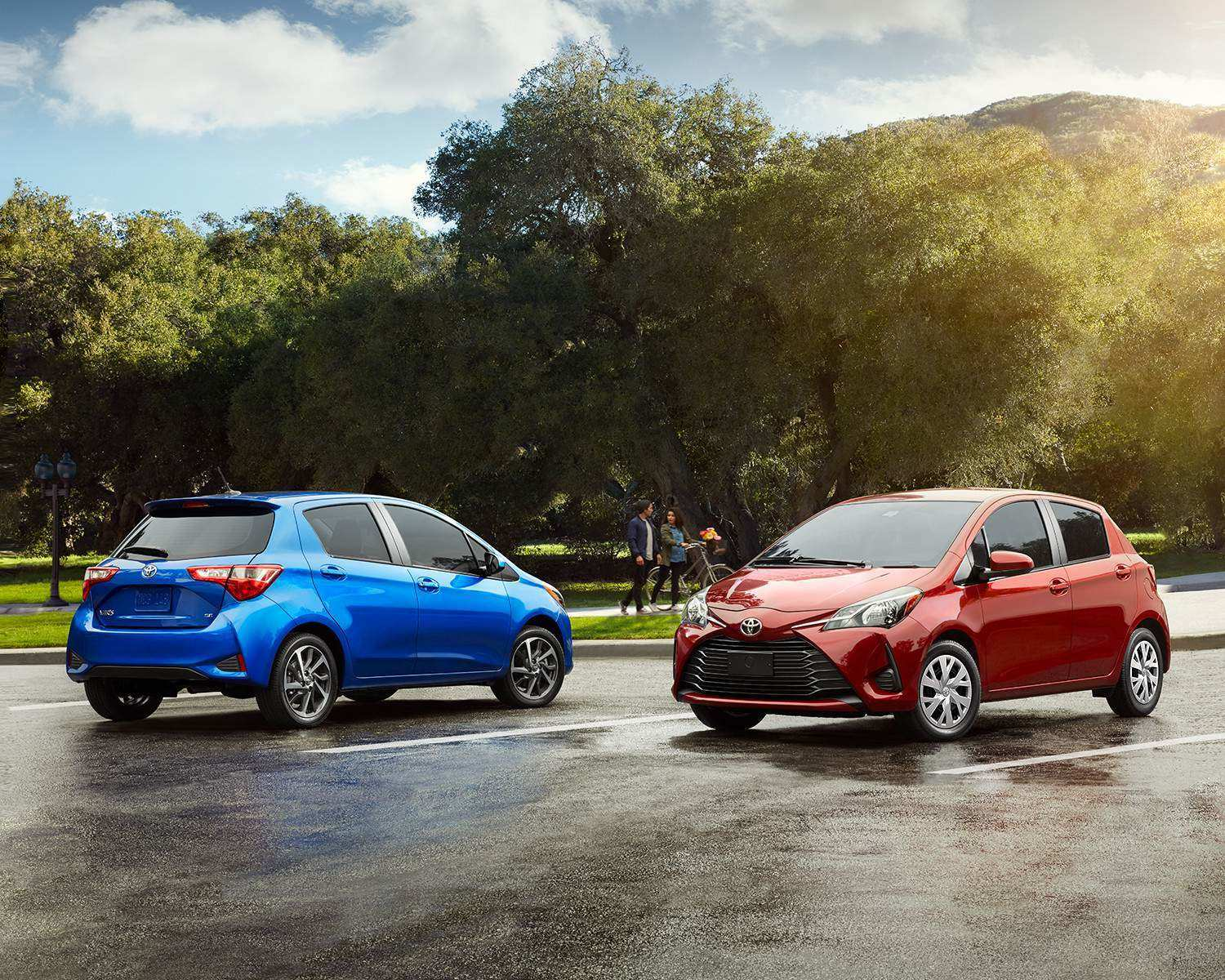 Blue and Red 2017 Toyota Yaris Vehicles Parked Outdoors